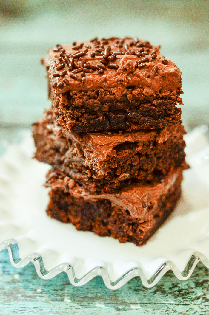 These Milk Chocolate Brownies are the most delicious brownies! Topped with chocolate buttercream frosting makes them irresistible.